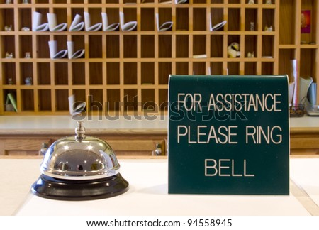 motel check in desk with bell and sign