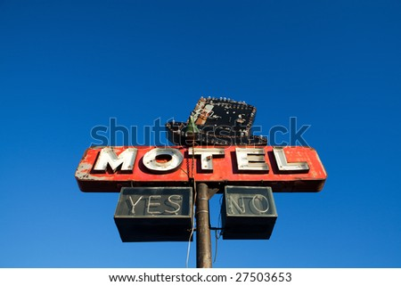 motel sign - abandoned motel retro style against clear blue sky - stock photo
