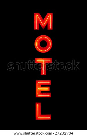motel sign neon retro closeup isolated on solid black - stock photo