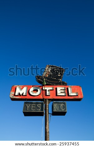motel sign retro style against a clear blue sky - abandoned motel deep in rural USA - stock photo