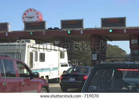 Moterists slow down to toll at the Golden Gate Bridge. - stock photo