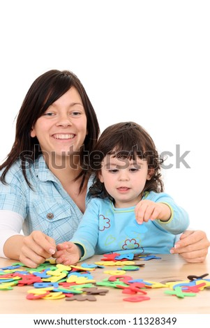 mothar and 2 years old girl with letters isolated on white