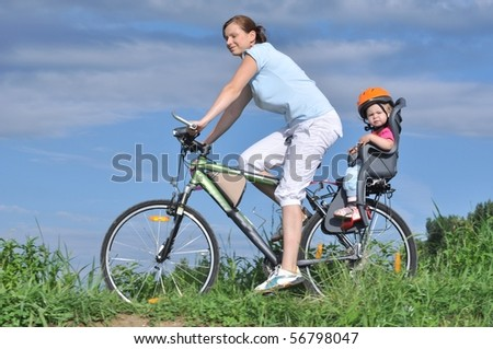 Mother and a daughter cycling
