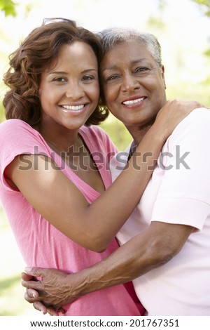 Mother and adult daughter portrait - stock photo
