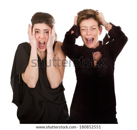 Mother and adult daughter screaming with fear.