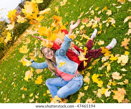 Mother and aughter in the autumn park - stock photo
