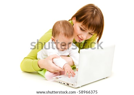 Mother and baby at the laptop, isolated - stock photo
