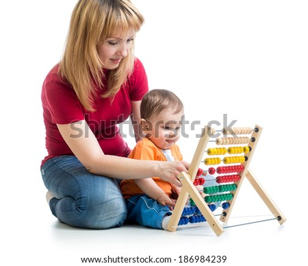 mother and baby boy play with abacus toy - stock photo