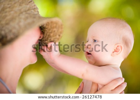 Mother and baby daughter outdoors at summer day - stock photo