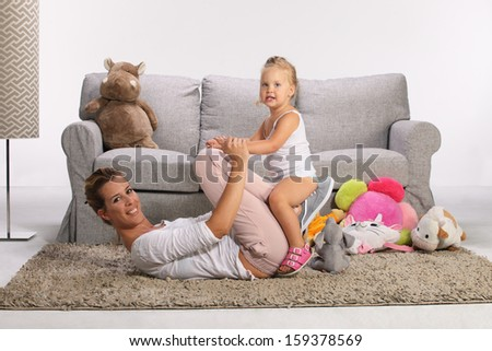 Mother and baby daughter playing  - stock photo