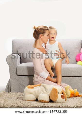 Mother and baby daughter playing 6 - stock photo