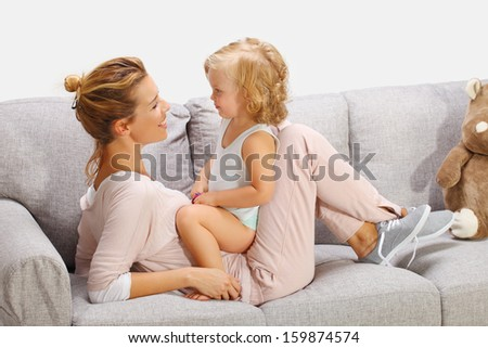 Mother and baby daughter playing 2