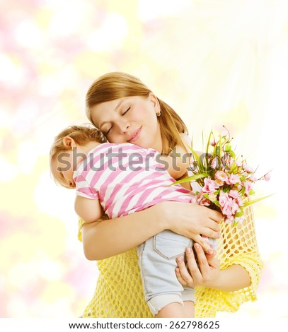 Mother and Baby Family Portrait with Flowers, Little Kid Embracing Mom, Child Congratulate Mothers Dat and Love Concept - stock photo