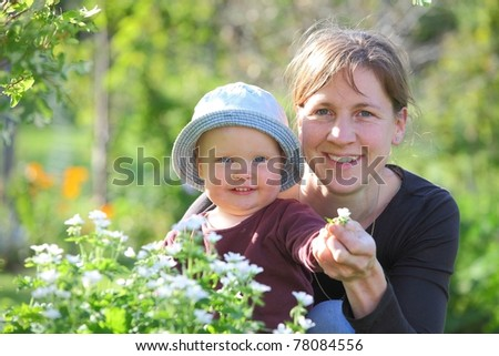 Mother and baby girl in the garden - stock photo