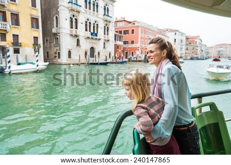 Mother and baby girl travel by venice water bus - stock photo