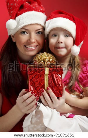 Mother and  baby girl with christmas gift