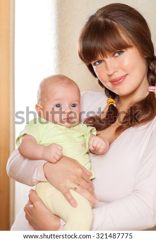 Mother and baby.  Happy family.Home interior. - stock photo
