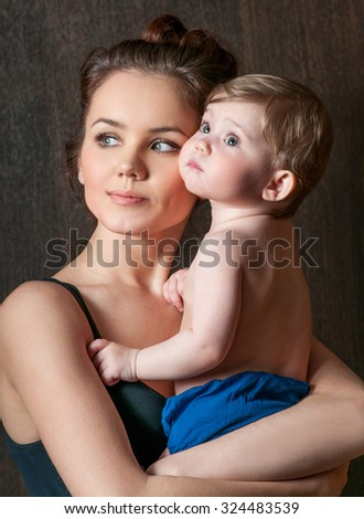 Mother and baby. Happy family. Mom's love and tenderness. - stock photo