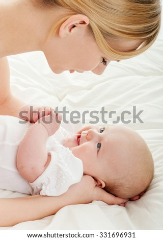 Mother and baby. Happy family. Mom's love and tenderness.