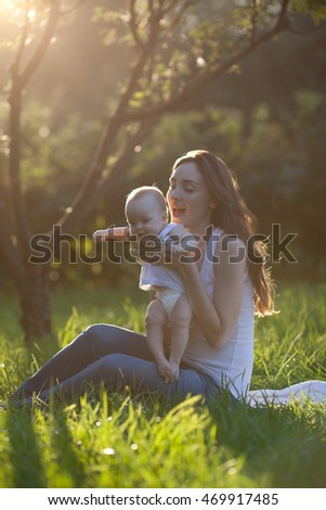 Mother and baby having fun at the park