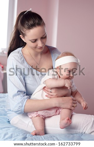 Mother and Baby hugging. Happy Family - stock photo