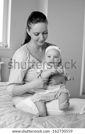 Mother and Baby hugging. Happy Family. Black and White - stock photo