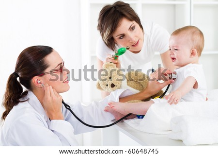 mother and baby in pediatrician office - stock photo