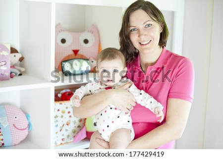 Mother and baby in playroom - stock photo