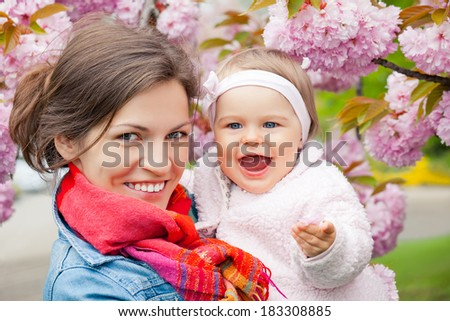 Mother and baby in spring garden