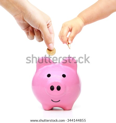 mother, and baby in the family do saving money in pink piggy bank - stock photo