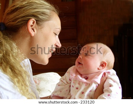 Mother and baby looking into each other's eyes - stock photo