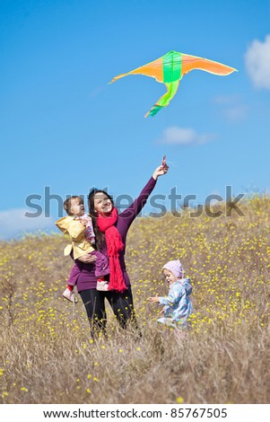 Mother and baby outdoors - stock photo