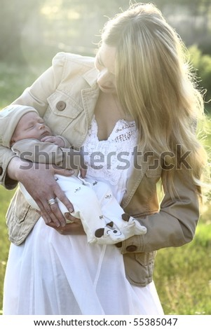 Mother and baby outside - stock photo