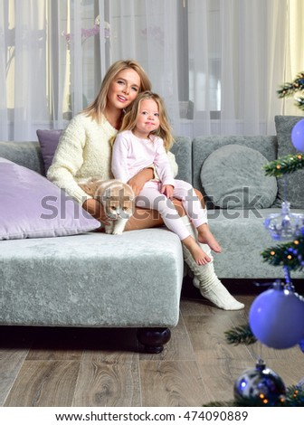 Mother and baby playing and smiling.Christmas time. Happy family.