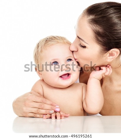 Mother and baby playing and smiling. Happy family.