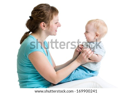 Mother and baby playing isolated on white background. Motherhood concept.