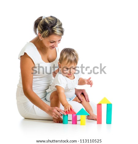 mother and baby playing with building blocks toy isolated on white - stock photo
