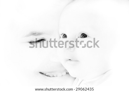 mother and baby portrait in high-key, focus on baby's eyes - stock photo