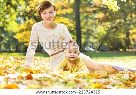 Mother and baby relaxing in the park - stock photo