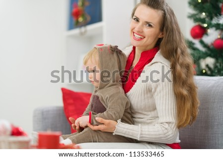 Mother and baby spending Christmas time together - stock photo