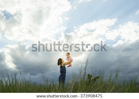 Mother and Baby - Vibrant color effect - stock photo