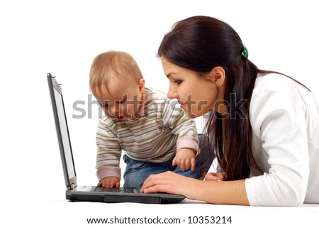 mother and baby with laptop - stock photo