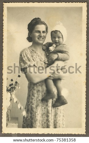mother and child, about 1945 - stock photo