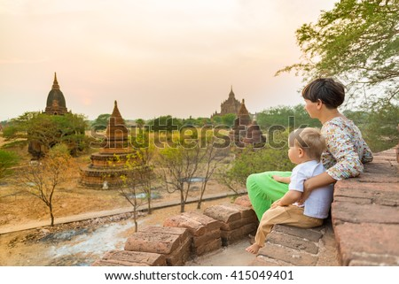 Mother and child are looking sunset from a pagoda in Bagan. Myanmar.  - stock photo