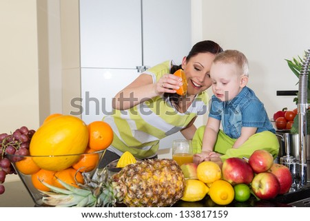 mother and child at kitchen - stock photo