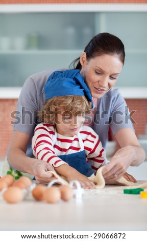 Mother and child doing Christmas baking and having fun - stock photo