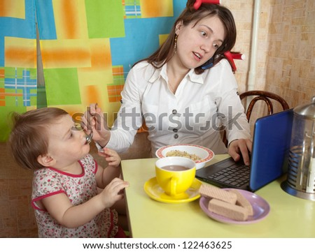 Mother and child eating breakfast in a hurry - stock photo