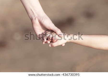 mother and child hand - stock photo