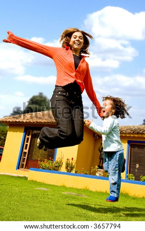 mother and child having fun at home - stock photo