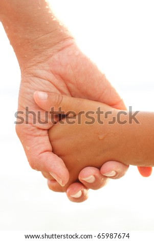 Mother and child holding each others hands - stock photo